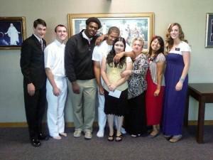Denesheo Moore, third from left, attends his friend Aaron's baptism. (Denesheo Moore)