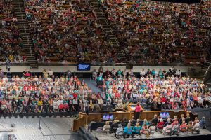 Women gather in the Marriott center to listen to speakers at a previous Women's Conference. (Maddi Dayton)