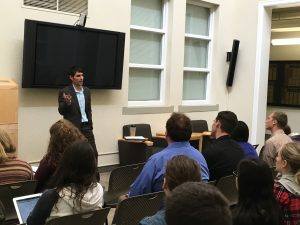 Journalist Frank Curreri speaks to communications students in the Brimhall atrium on Thursday