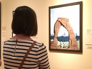 Emily Cameron of American Fork enjoys a painting of the Delicate Arch at the BYU Museum of Art (Jennifer Ball)