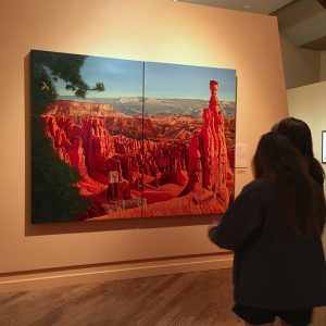 BYU Museum of Art visitors view Anton J. Rasmussen's painting of Bryce Canyon. (Jennifer Ball)