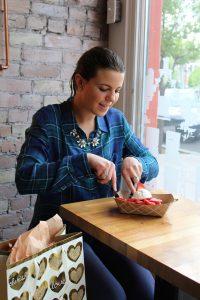 BYU student Lindsay Bush making plans for Mother's Day at Bruges Waffles & Frites