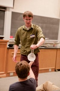 YChem president Alex Farnsworth taught elementary aged kids at the Open Lab Day on Saturday, May 14. (Maddie Driggs)