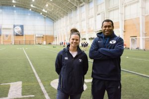 From left: Assistant coach Kayla Richardson and head coach Tom Waqa at a team practice. The Cougars will take on Penn State for the national championship on May 7. (Natalie Saunders)