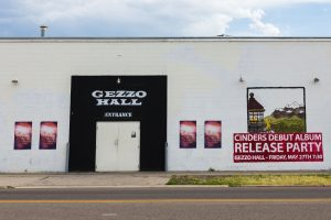 The local concert venue Gezzo Hall paints large murals on the side of their building to promote their concerts and events. (Chase Lewis)