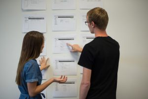 Founder Riley Adamson and Account Manager Madeline Skillings discuss future plans for Checkup database. (Emily Waddell)