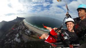 Johnny Neu hang gliding over Rio where he will be taking NBC clients (Johnny Neu)