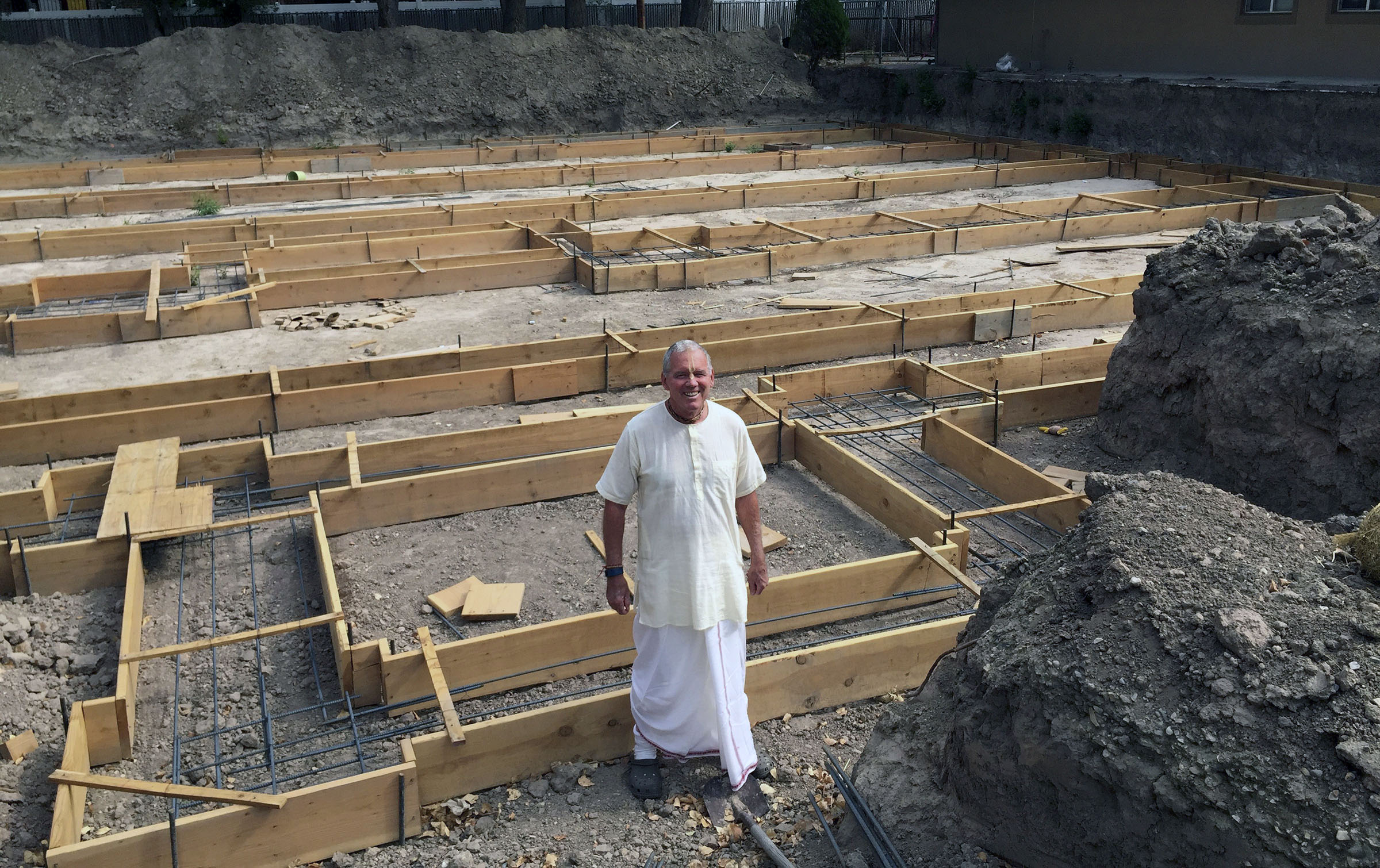 In this Aug. 4, 2016 photo, Caru Das, Utah Hare Krishna leader,poses at the construction site for the Salt Lake City Krishna Temple in Salt Lake City. (AP Photo)