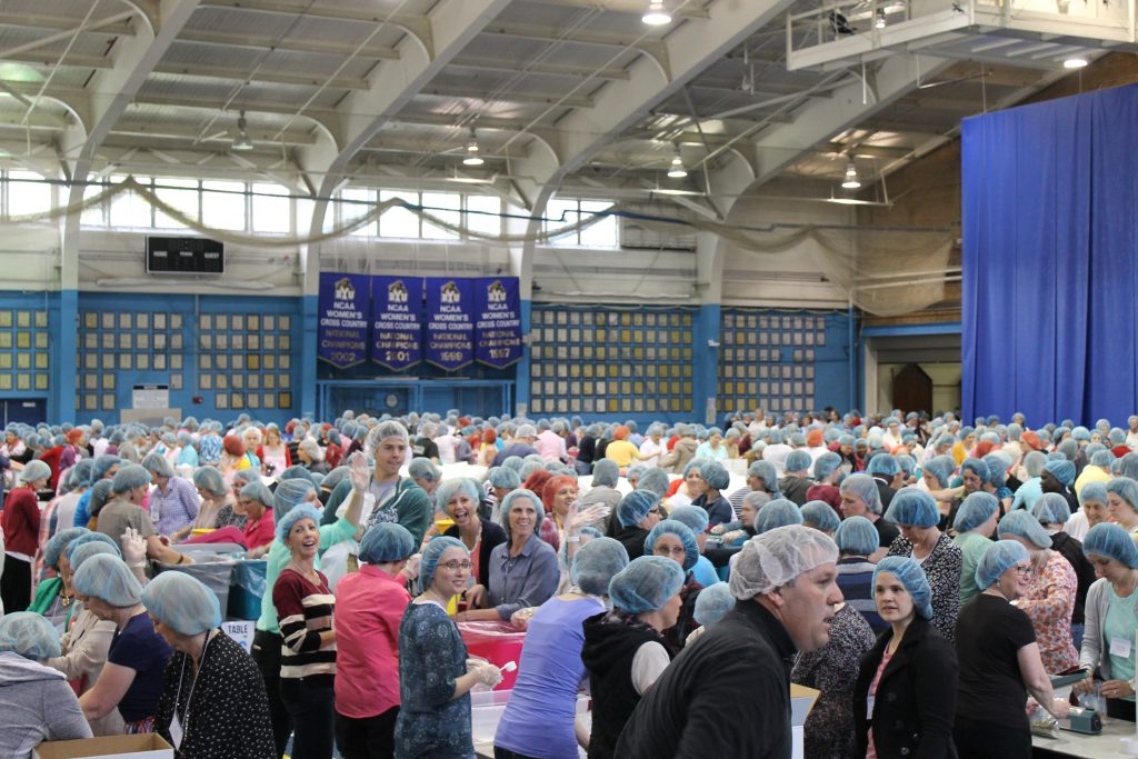 After: Women's Conference participants help assemble meal kits