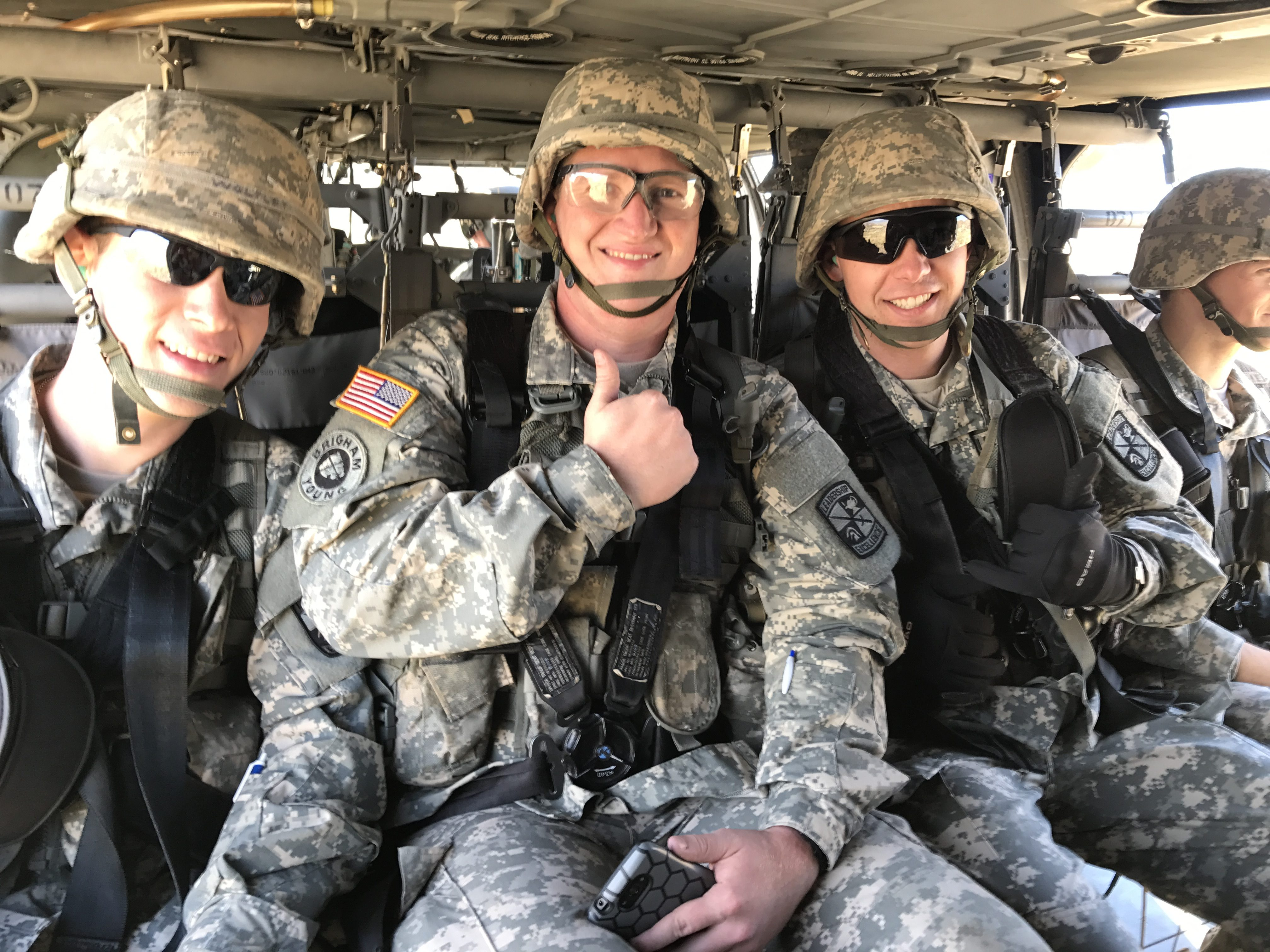 cadets hyrum dean greyson link and kal holyoak sit in a black hawk as part of the rotc helicopter event last thursday kal holyoak