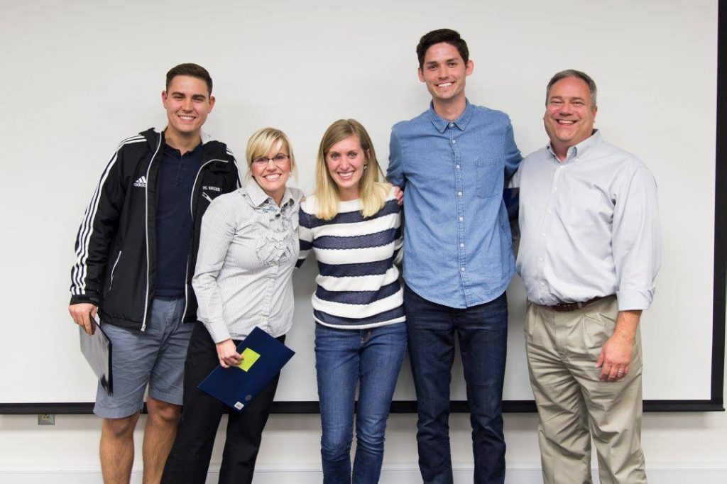 Changemaker Film Competition judges pose with winner Emily Brand. From left to right is judges Camden Robinson and Ann Earl winner Emily Brand, judge Troy Looper, and Ballard Center director Todd Manwaring. (Jessica Bowles)