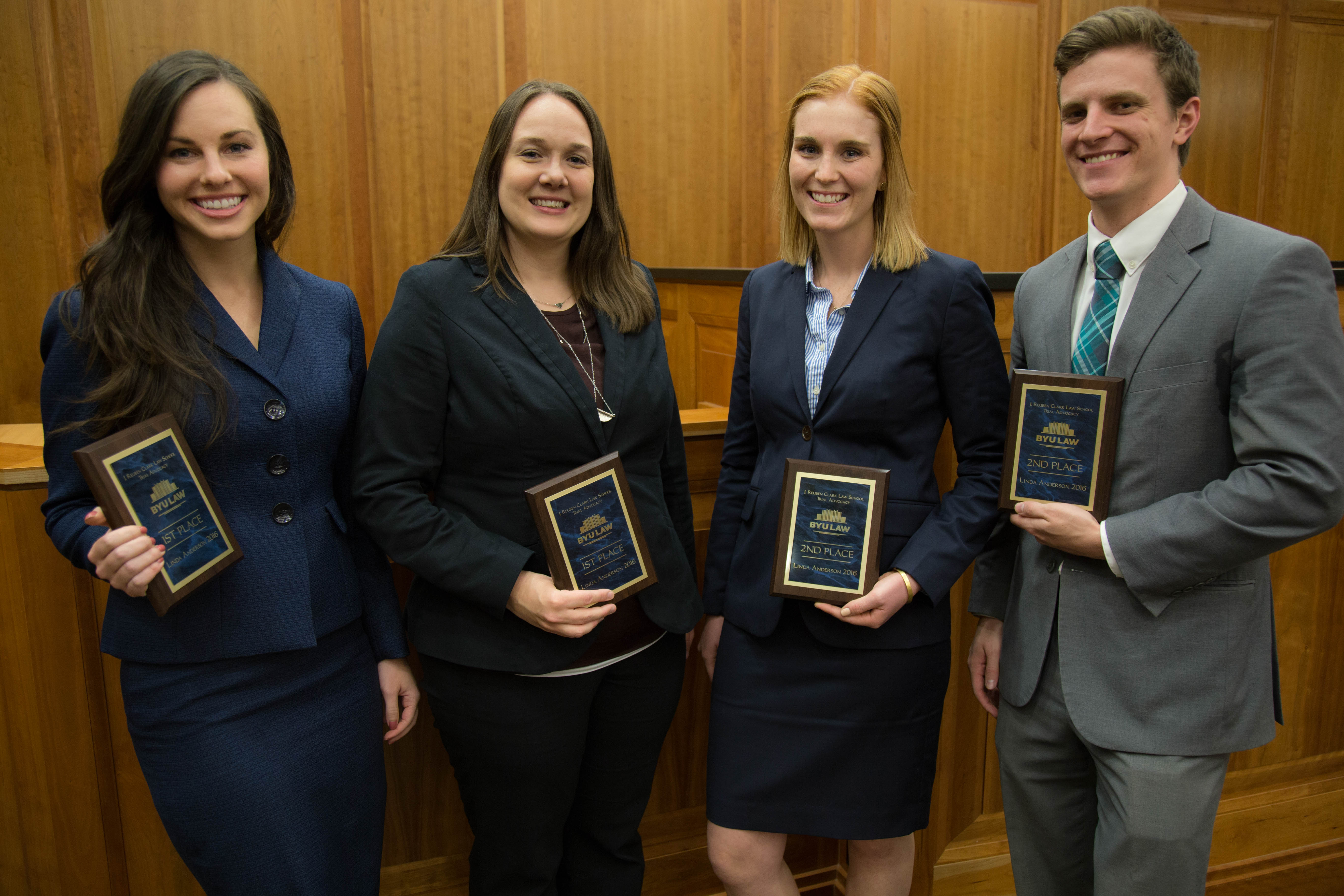Krista-Lee Crook and Samantha Scott hold their first place plaques. They stand next to their competition, Bronwen Evans and Mike Snell. (BYU Law School)