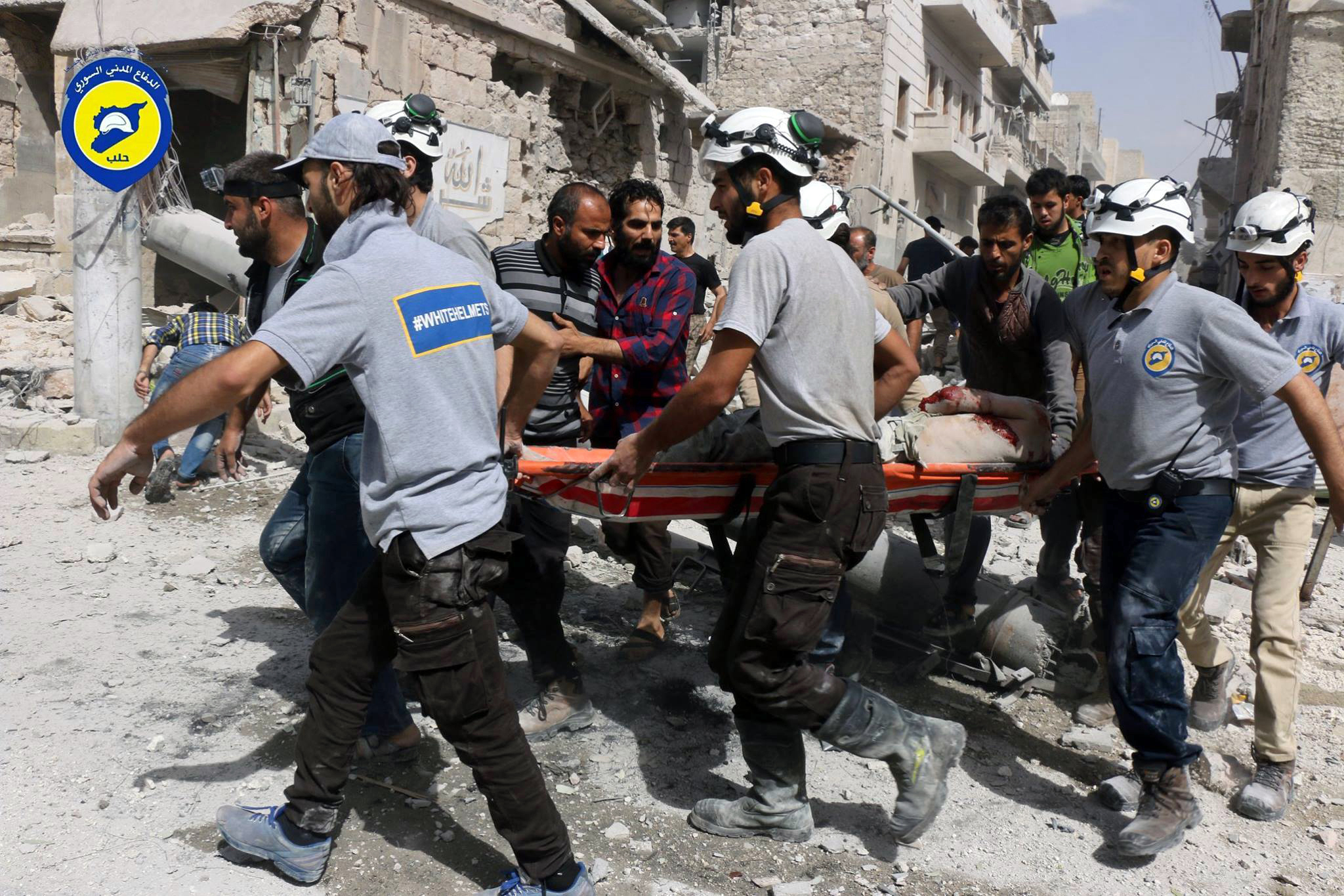 FILE - In this Wednesday, Sept. 21, 2016, file photo, provided by the Syrian Civil Defense White Helmets, rescue workers work the site of airstrikes in the al-Sakhour neighborhood of the rebel-held part of eastern Aleppo, Syria. Violence in Aleppo has surged in recent days as a U.S.-Russia-brokered cease-fire collapsed after one week. The Syrian government and its ally Russia have resumed intense airstrikes and Syrian military officials have spoken of a looming ground offensive against rebel-held districts. (Syrian Civil Defense White Helmets via AP)