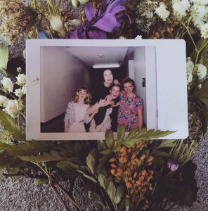 Alissa Mitchell and her friends take a photo with a Polaroid camera. (Alissa Mitchell)
