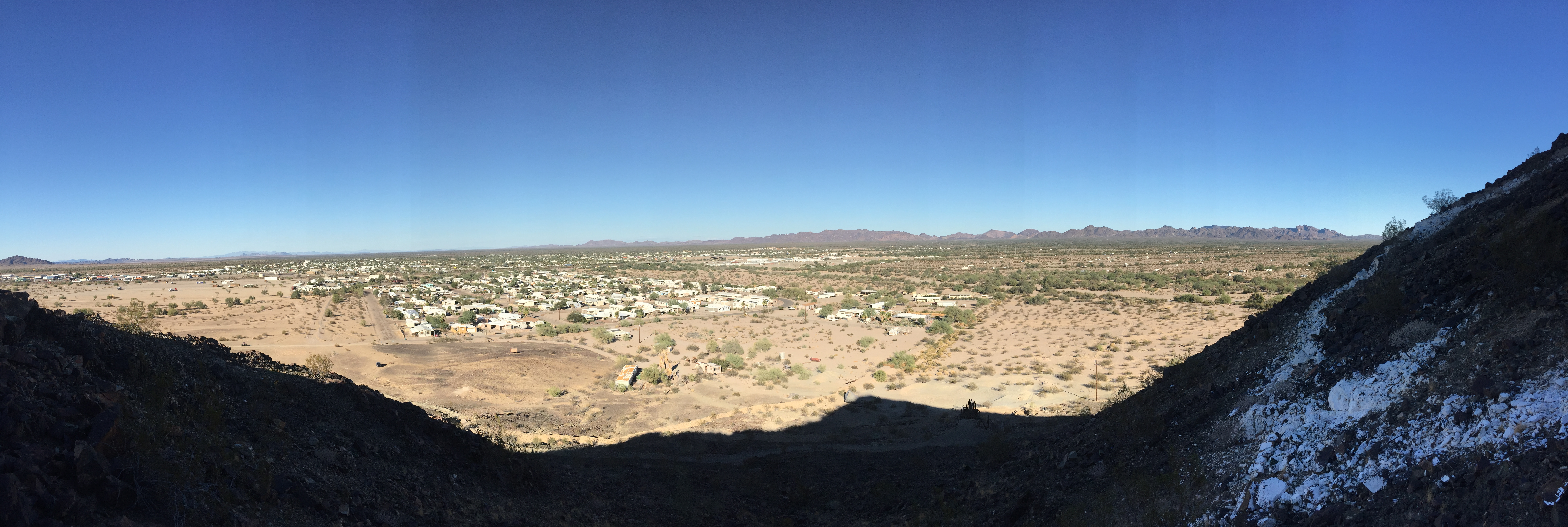 The view of Quartzsite from Q Mountain. According to the 2010 census, the population is 3,677.