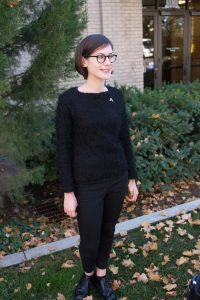 Elora Clement, an advertising major from Texas, wore all black as a sign of mourning on Nov. 9. She also wore an eagle pin upside down. (Ryan Turner)