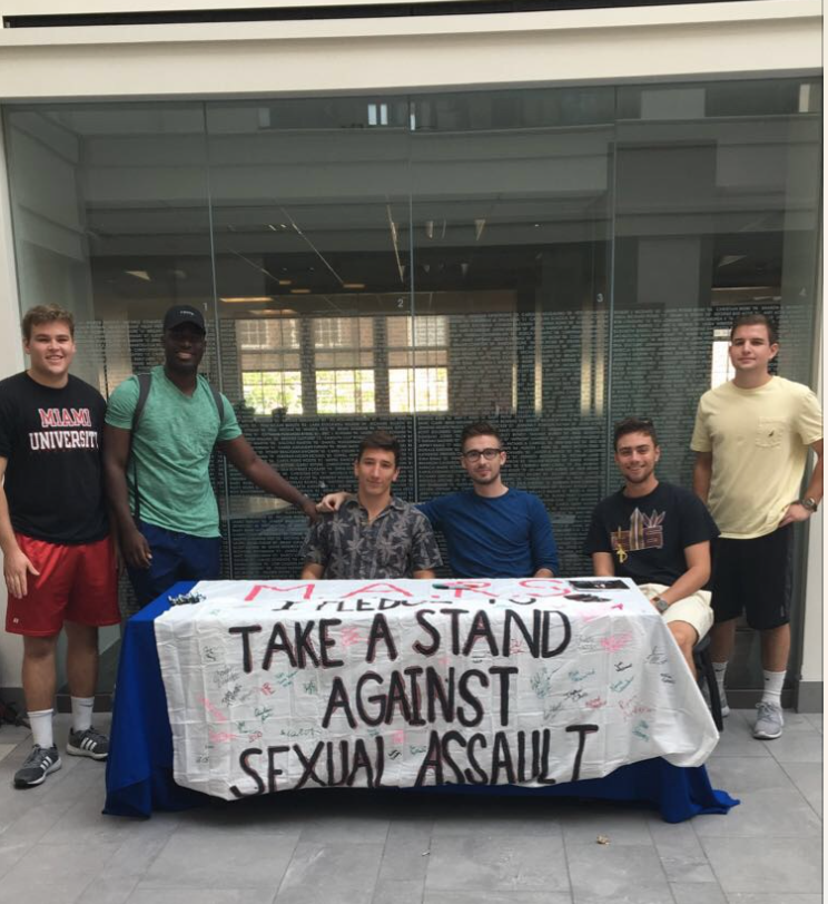 Gabriel Hansen (president) and his fellow MARS members raise awareness of sexual assault at Miami University of Ohio. (Photo: Chase Halter)