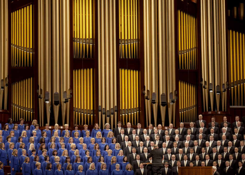 FILE - In this Oct. 3, 2015 file photo, The Mormon Tabernacle Choir sings during the opening session of the two-day Mormon church conference in Salt Lake City. The church announced on its website Thursday that the 360-member volunteer choir will sing at Trump's swearing-in ceremony on January 20. (AP Photo/Kim Raff)