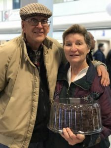 Charlotte and Kip Maxwell of North Salt Lake, Utah, brought a chocolate cake to welcome the last Utah refugee family from a banned country. (Kjersten Johnson)