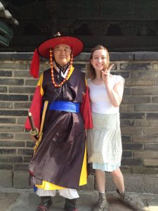 Madelyn Lunnen poses with a guard at a historical military base in South Korea. (Madelyn Lunnen)