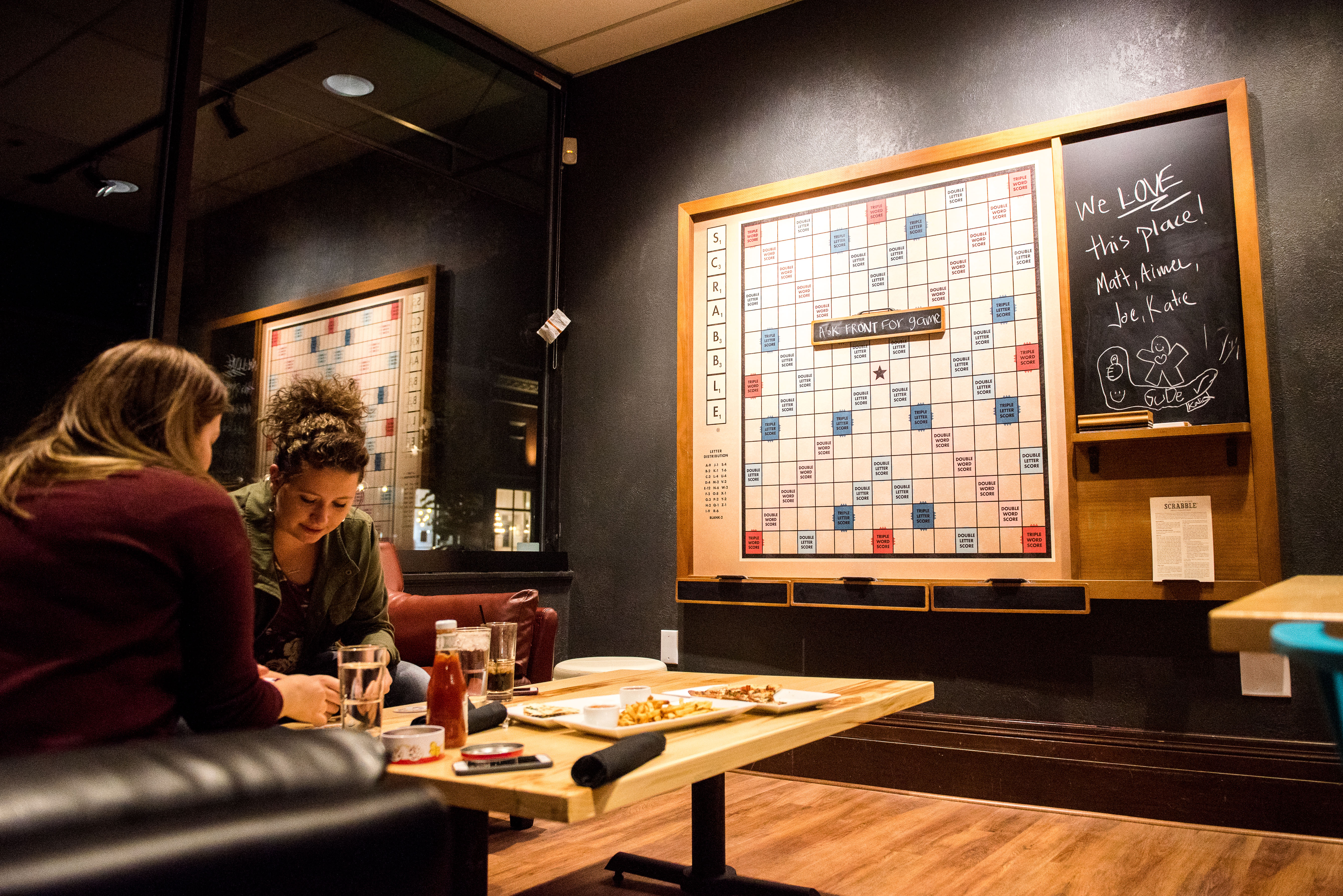 Liz Jensen Plays Games While Enjoying Dinner At Good Move Café. (Savannah  Hopkinson)