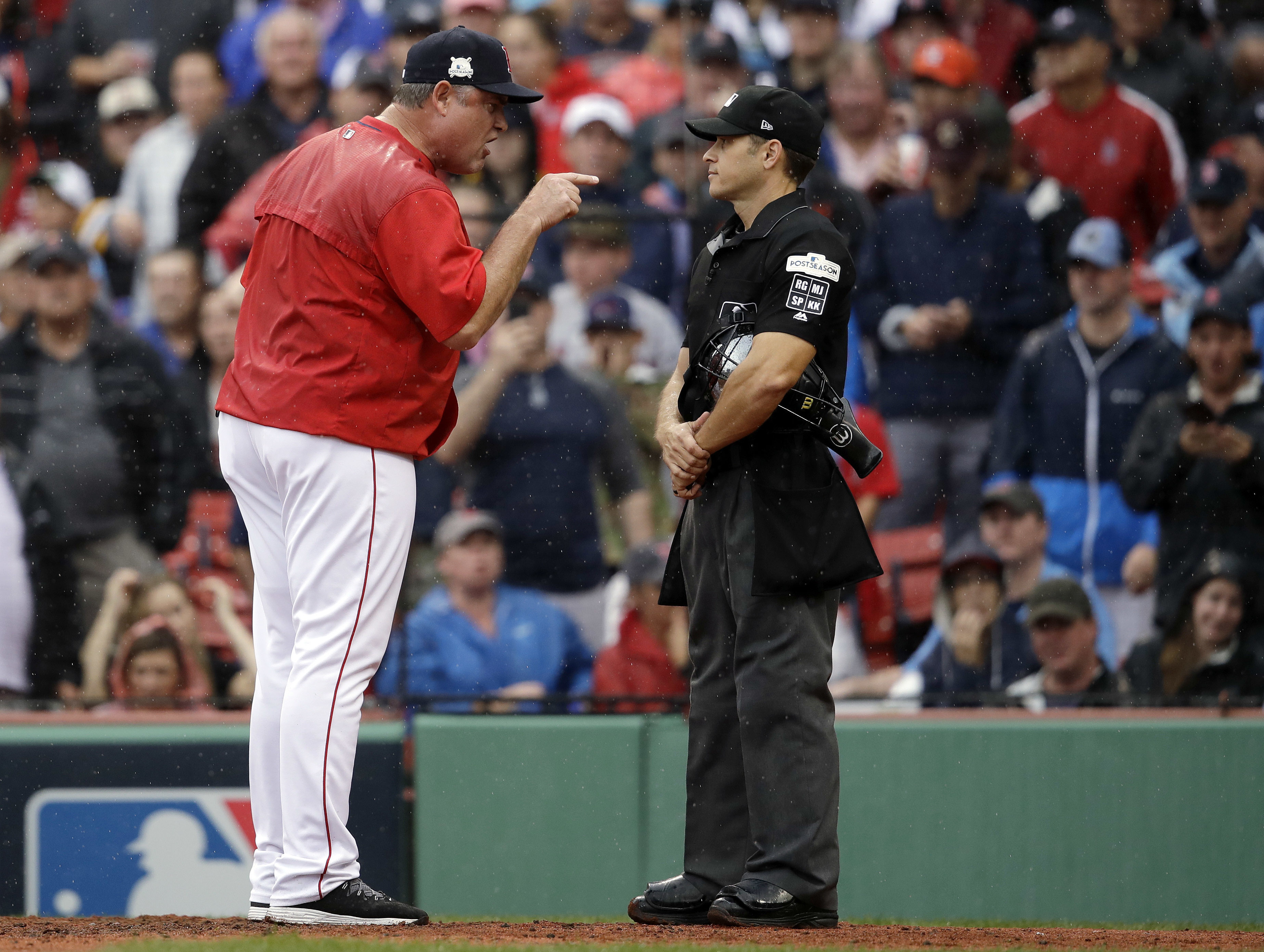153e2678af7366 In this Monday, Oct. 9, 2017, photo, Boston Red Sox manager John Farrell,  left, argues with home plate umpire Mark Wegner, right, during the second  inning ...