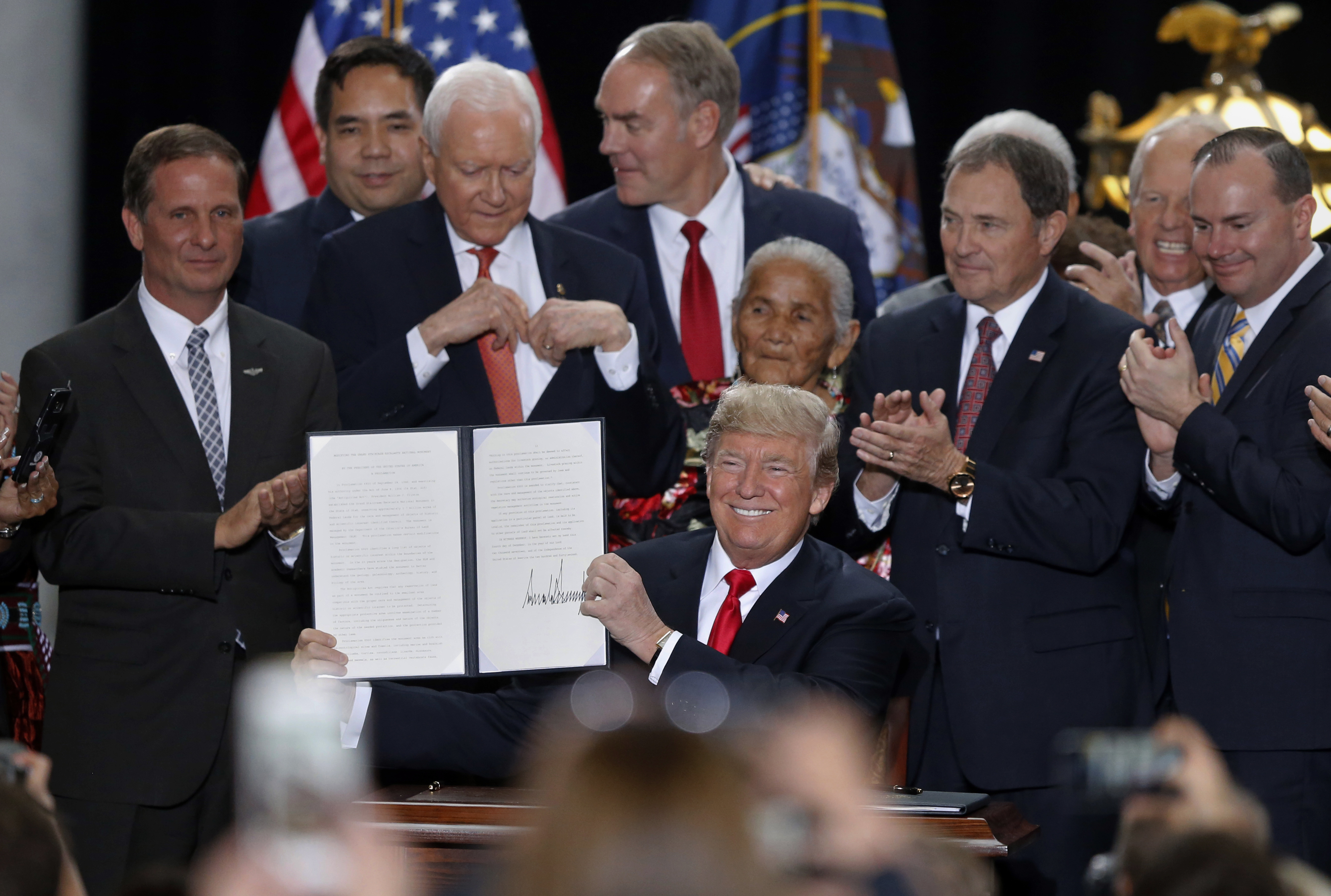 3d91744c30b0 President Donald Trump holds up a signed proclamation to shrink the size of  Bears Ears and Grand Staircase Escalante national monuments at the Utah  State ...
