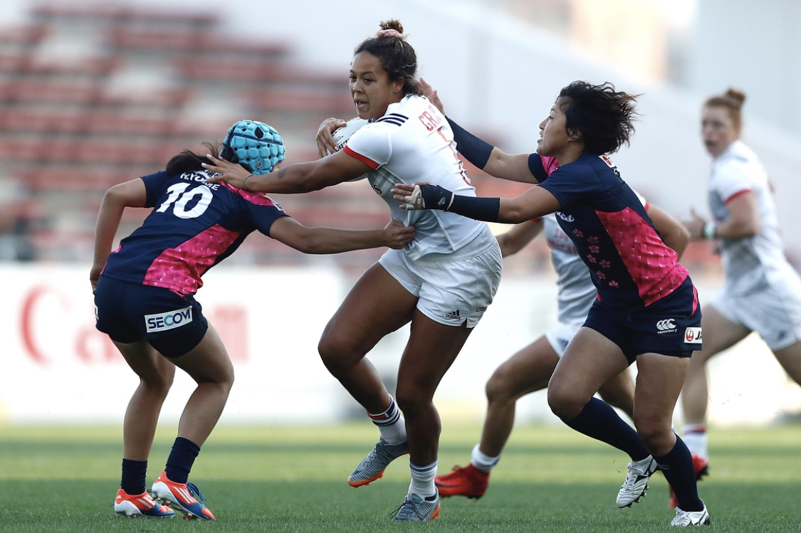 Jordan Gray Of The Usa Women S Eagles Fights Off Opposing Team As She Drives Ball For A Try Mike Taiwan