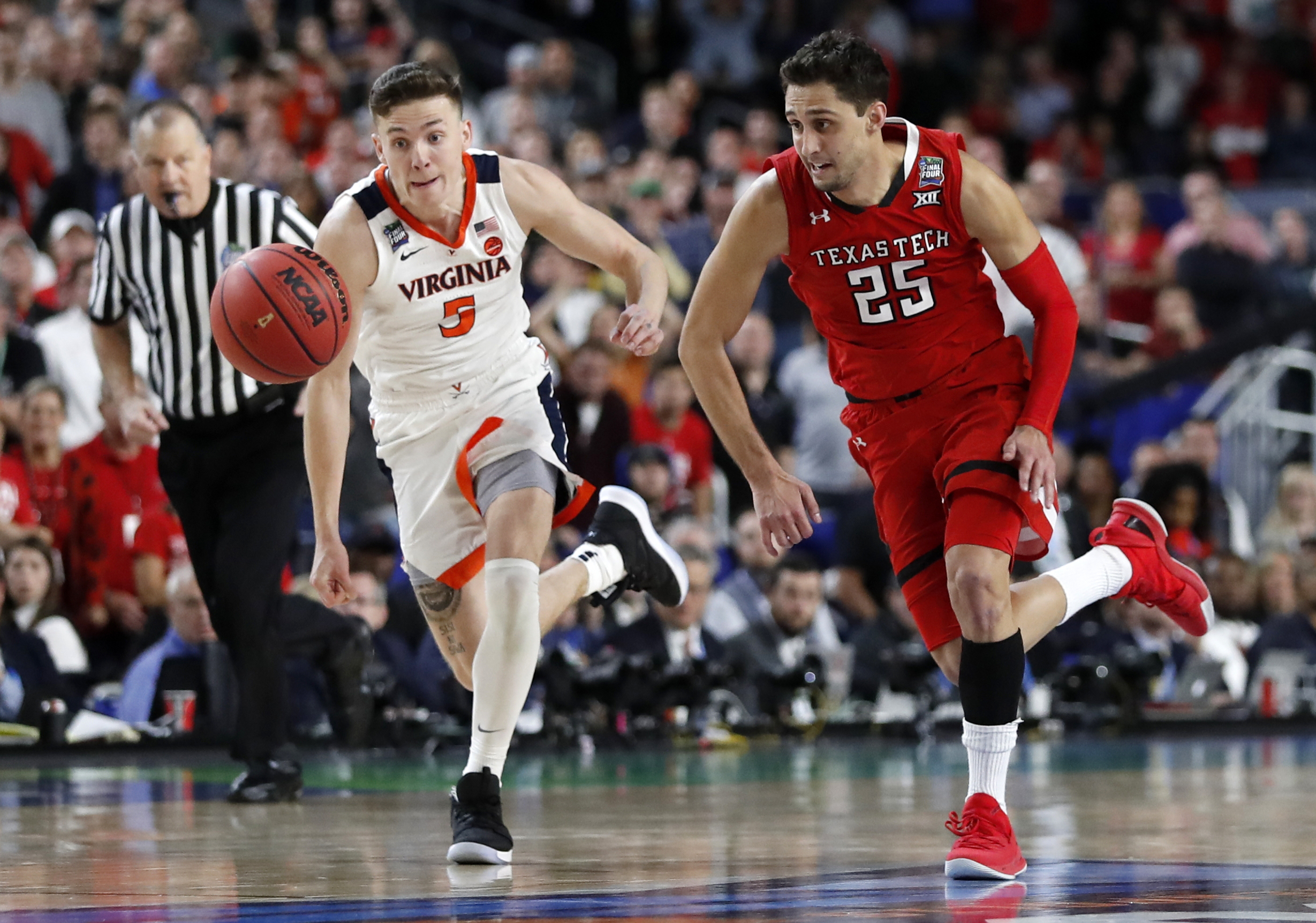 super popular 59b12 0f12d Virginia s Kyle Guy (5) and Texas Tech s Davide Moretti (25) chase a loose  ball during the overtime in the championship of the Final Four NCAA college  ...